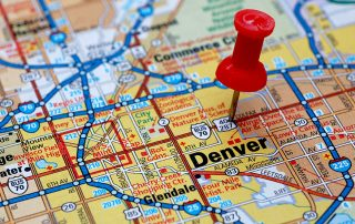 a pinpoint on a map of denver